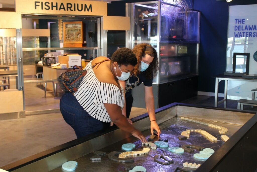 Guests interacting with the River Alive exhibit at The Independence Seaport Museum