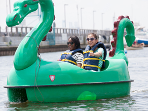 Two women paddling a dragon boat at The Independence Seaport Museum