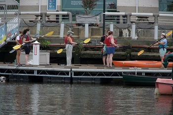 Guests getting ready for a kayak excursion at The Independence Seaport Museum