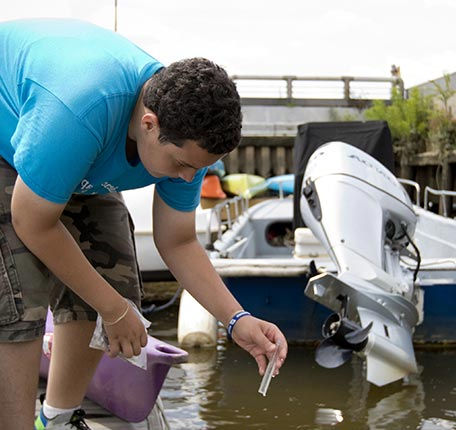 Taking a water sample from the river at The Independence Seaport Museum