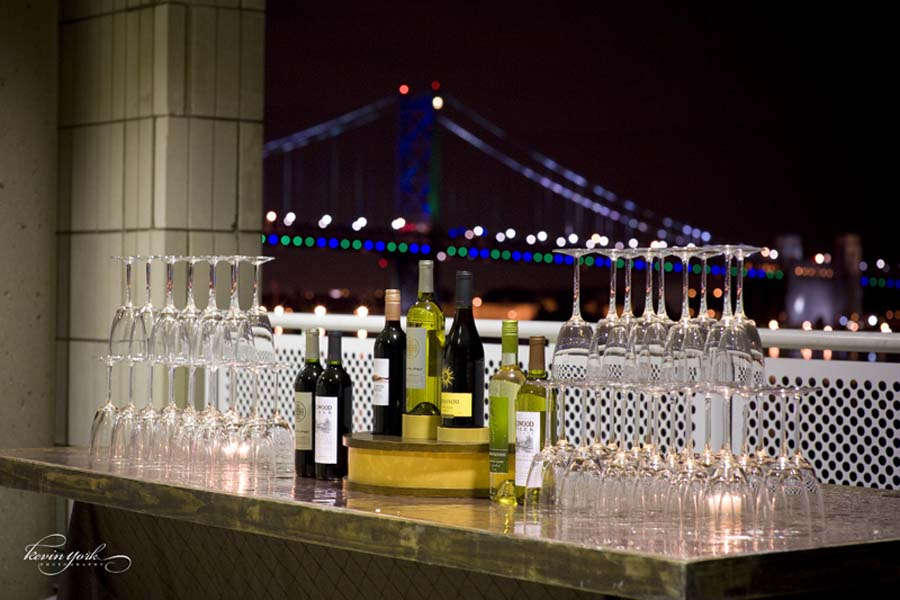 Wedding reception bar with wine bottles and glasses