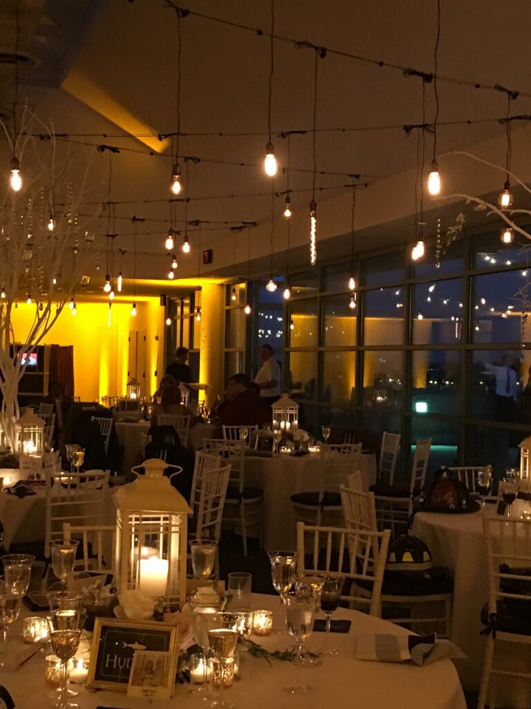 Wedding venue setup with tables and centerpiece displays