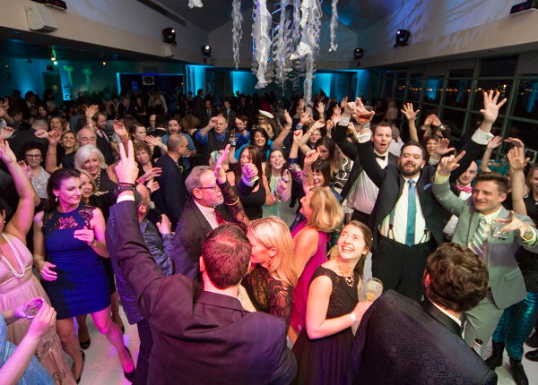 Wedding guests dancing and having fun at a wedding reception at The Independence Seaport Museum