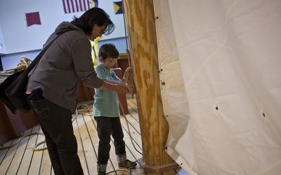 Mother and son interacting with rigging at The Independence Seaport Museum