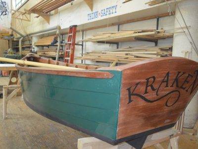 Photo of Kraken dinghy in the ship builder shop at The Independence Seaport Museum