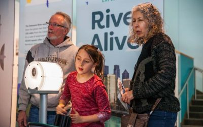 Young girl with parents looking at the River Alive exhibit at The Independence Seaport Museum