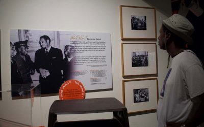 Museum guest reading information in the Tides of Freedom exhibit at The Independence Seaport Museum