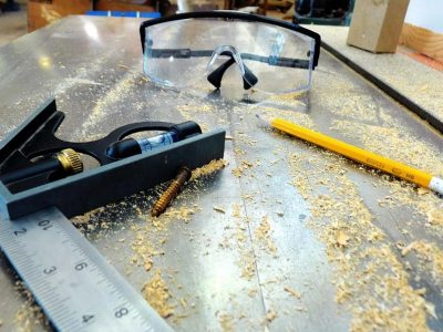 tools sitting on a table saw